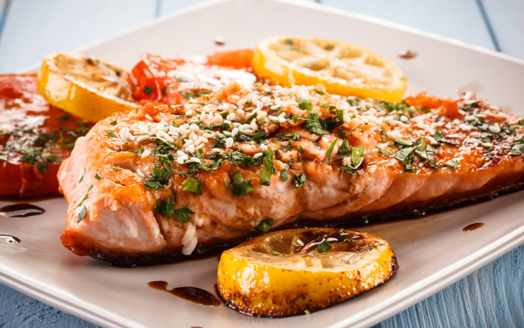 Roasted fish with tomato and olive oil sauce
